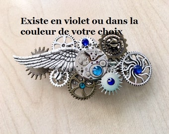 Steampunk hair clip, silver watch mechanism, angel wing, cogs and blue Swarovski crystal