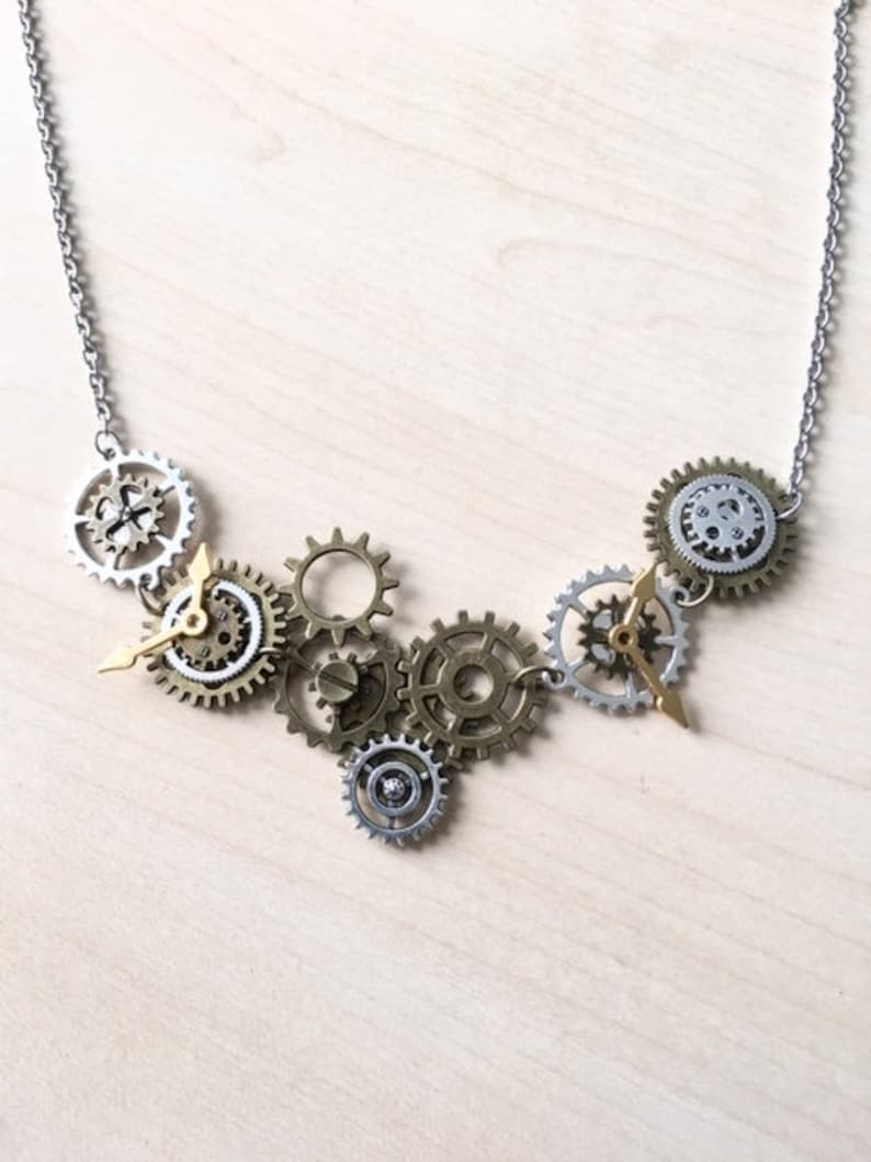 Bronze and silver steampunk asymmetrical necklace with wheels and angel wings on stainless steel chain