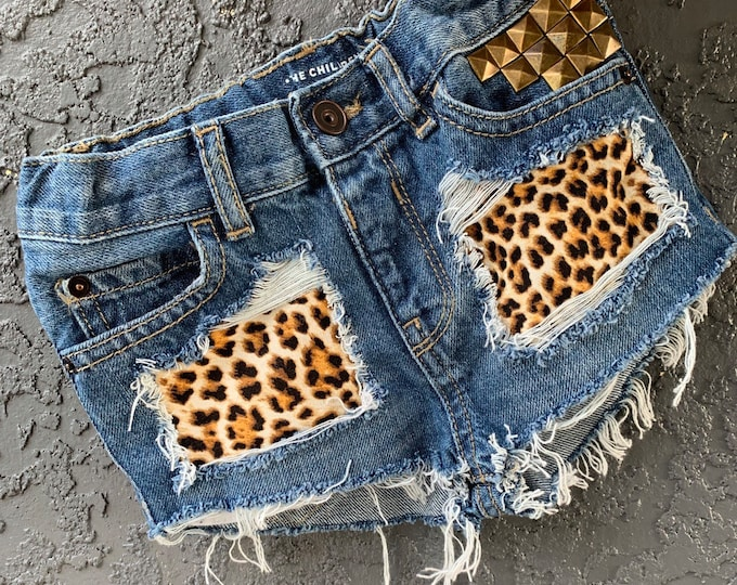4ff469cabf KITTEN ME baby girl toddler destroyed distressed peekaboo leopard cut off  denim jean shorts with studs