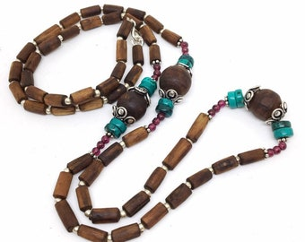 2952be76bc8 Ladakh Tulasi Necklace with Garnet and Turquoise.