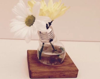 Quirky bulb vase with solid oak base.
