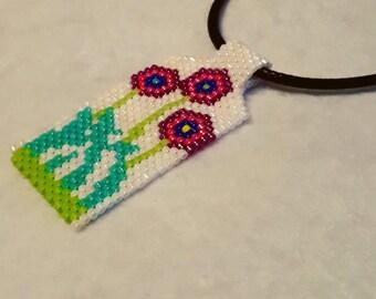 Unique charm necklace with flowers.