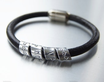 Secret Message bracelet, spiralled aluminium personalised motif on a 6mm leather strap with stainless steel magnetic clasp.