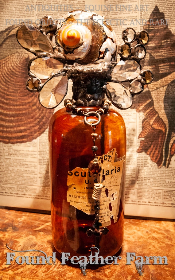 "Magnificent Handmade Seashell Cross Bottle with an Antique Labeled 1880 Amber Glass Bottle From the ""Ocean Collection"""