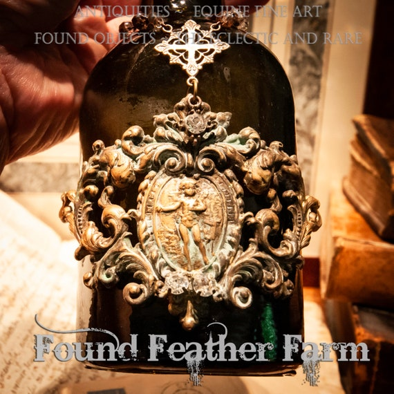 A Stunning Handmade Cross Bottle With an Antique Dark Green German Bottle from the late 1870's