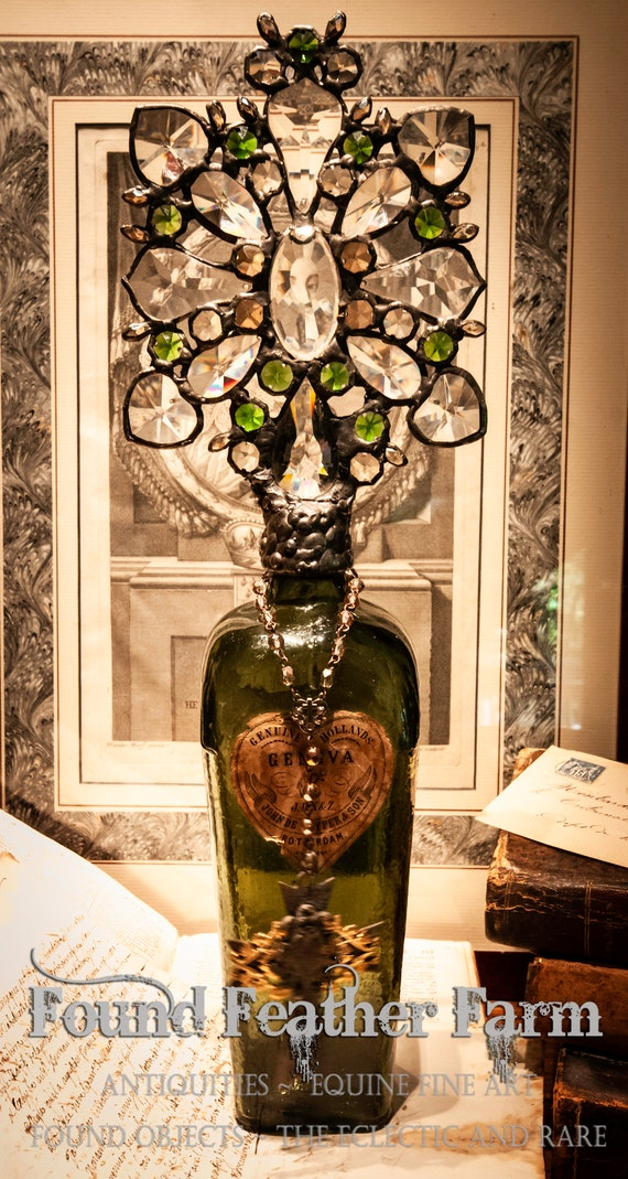 Handmade Glass Cross Bottle with a Rare Late 1800's Antique Olive Green Gin Bottle with the Original Paper Label