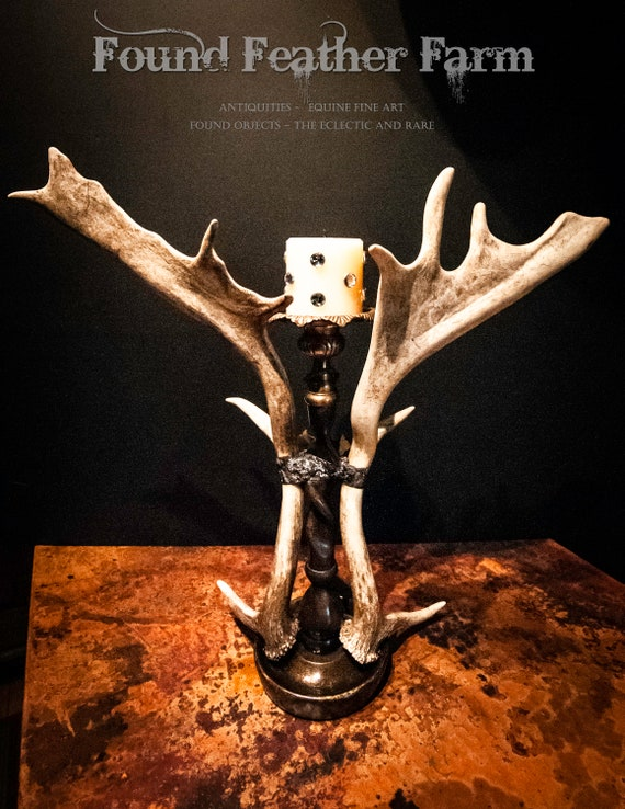 Vintage English Fallow Antlers adorn a Tall Bronze Candleholder, a Brass Cross and Vintage Brooch