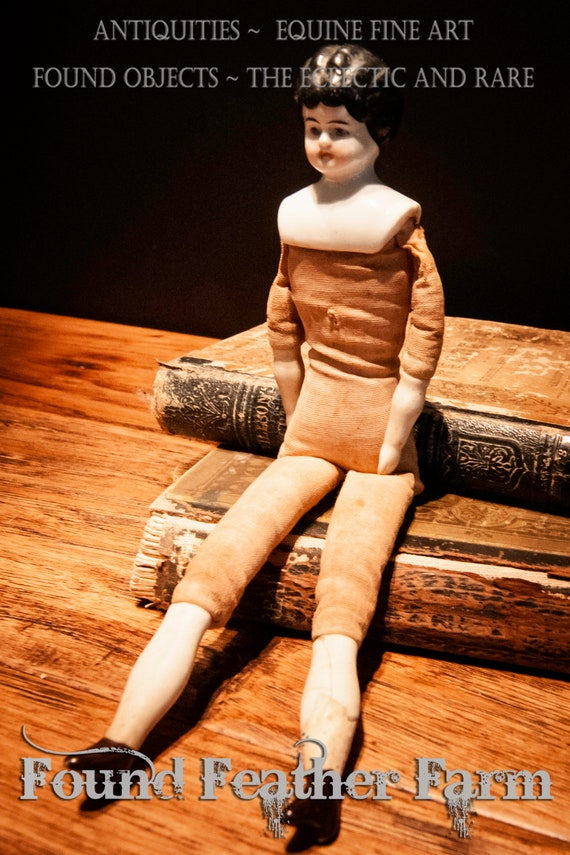 Large Antique German Doll with Porcelain Head, Arms and Legs and Dressed in Raw Muslin