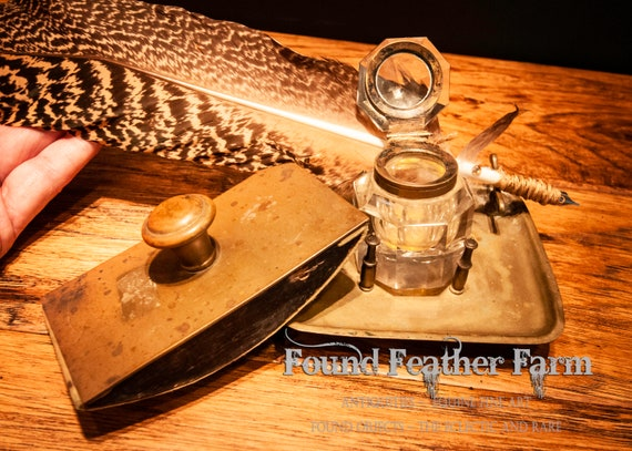 Antique Brass Ink Bottle And Holder with a Brass Blotter and Feather Quill Pen