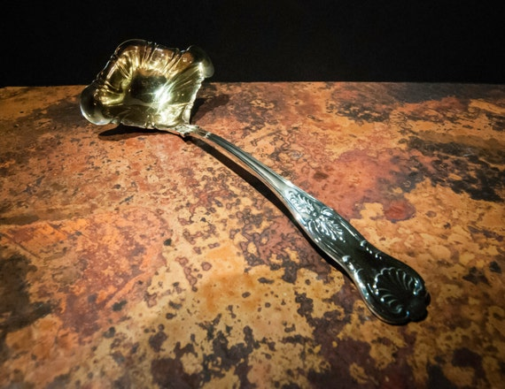 English Silver Plate and Gold Ladle