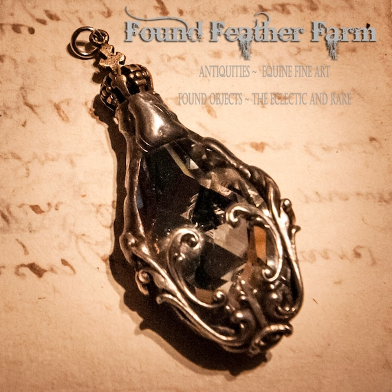 Handmade Soldered Crystal Teardrop Pendant Embellished with a Silver Finding and a Bronze Crown End Cap