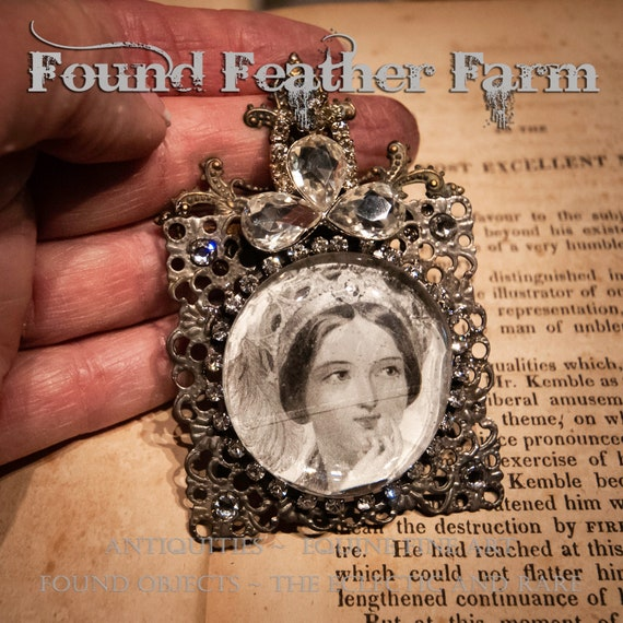 Handmade Magnet with a Jeweled Embellished Glass Cabochon Featuring a Victorian Woman and a Brass Maltese Cross