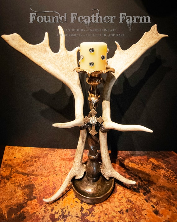 Vintage English Fallow Antlers Adorn a Tall Bronze Candleholder With a Brass Cross and Vintage Brooch