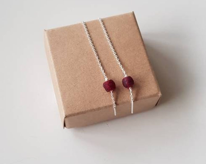 Earrings on real silver material. Red recycled glass beads from Ghana. Jewellery handmade in Denmark.