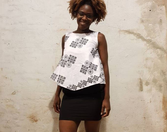 S. Dress style top and skirt. African fabric. Elegant and chic. Fully lined. Made in Ghana.