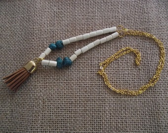 Necklace with brown suede tassel and stabilized turquoise beads