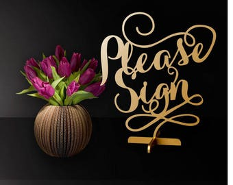 Please sign. Table sign.