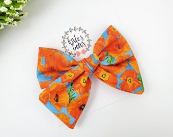 df99768ed1e675 Turquoise with bright orange poppies Millie style fabric hair bow, tied bow,  orange, turquoise, hair bows, summer bows, Kate's Bows