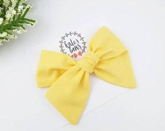 Coral lemon hand tied bow nylon headband or clip