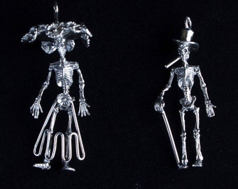 Bones Alive Couple, Sterling Silver Ka Catrina and Bone Daddy Pendants including a 20 inch Sterling Silver box chain.