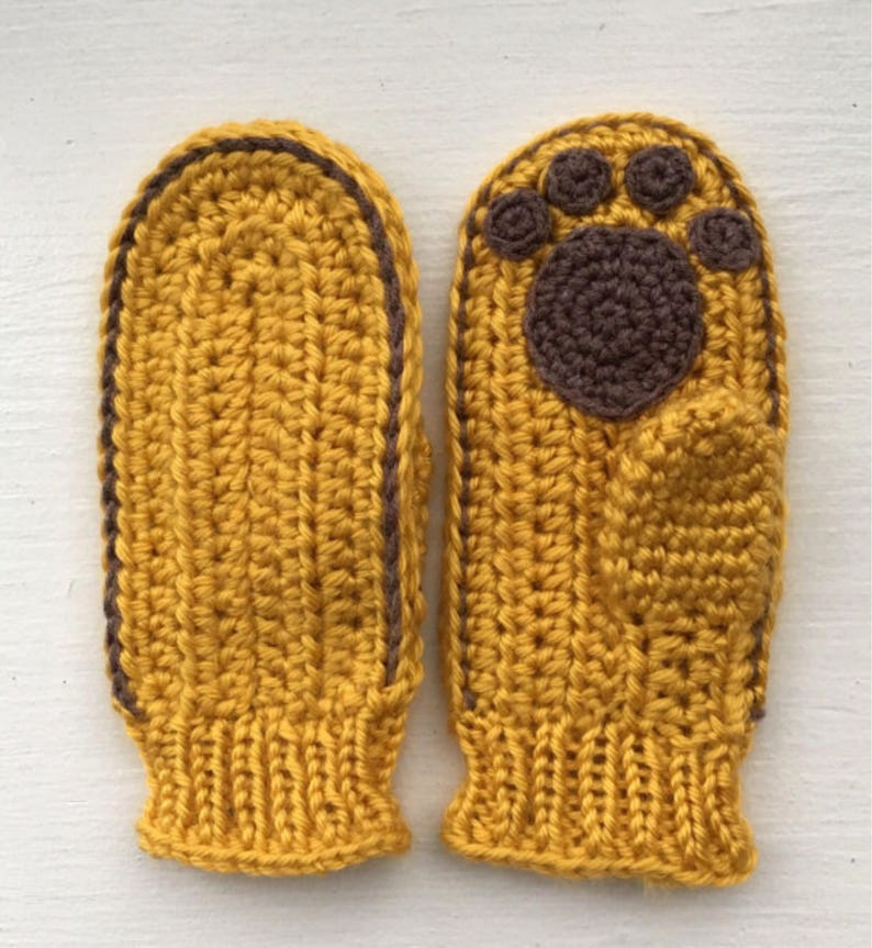 English USA Read description of listing before to buy. Mittens with paws crochet pattern PDF
