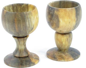 Sold by two country wooden egg Cup.