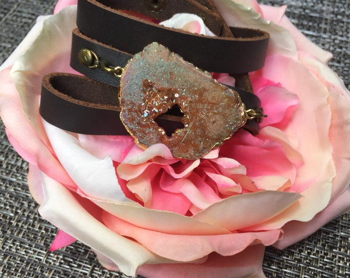 Featured listing image: Druzy Leather Wrap Bracelet by Captivating Capricorn Iridescent Rose Gold Druzy Agate Slice on Brown Leather with Adjustable Snap Clasp