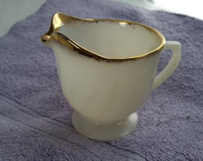 Anchor Hocking Fire King Cream Milk Pitcher Footed Beige Swirl Gold Trim