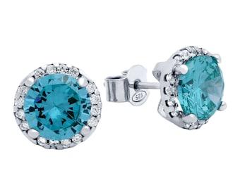 Blue topaz earrings. Sky blue topaz earrings. Sterling silver cz sky blue topaz earrings. Silver earrings. December birthstone earrings.