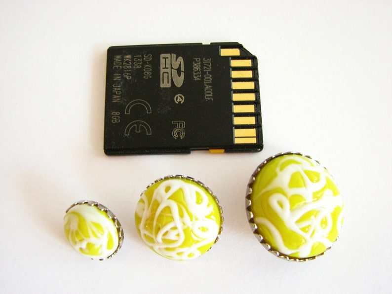 yellow and white buttons whith silver metal base Metal and glass buttons 3 sizes to choose from