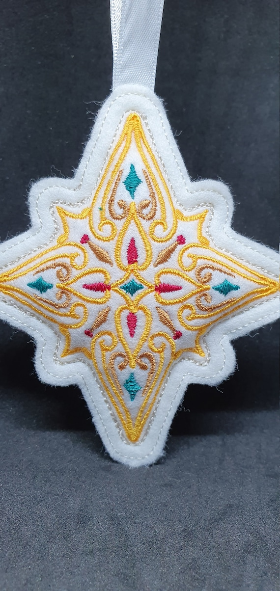 X060.     Christmas filigree star ornament.