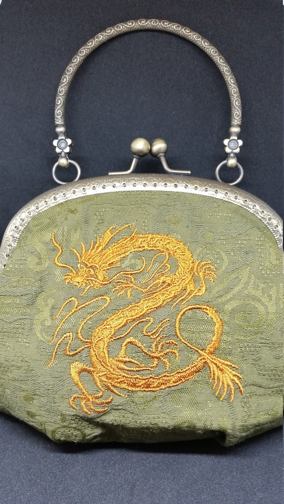 B604.  Chinese dragon design clutch purse.