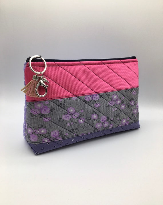 S - 077 Washbag/toiletries bag/cosmetics bag in pink and mauve. Made using gents, up cycled ties with a stunning result!