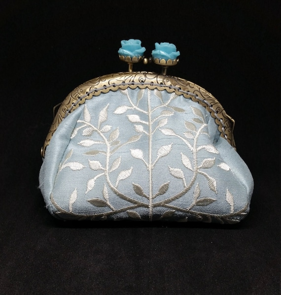 CP662. Small puffy coin purse. Embroidered pale blue satin fabric