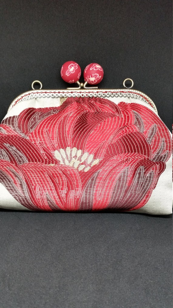 B500.  Small clutch bag with chain and large poppy design