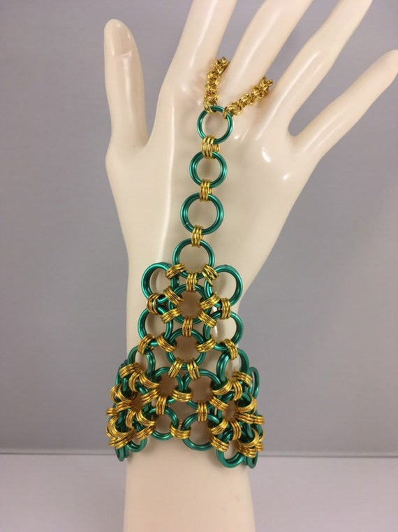 S - 689 Hand harness/cuff in green and gold chainmaille