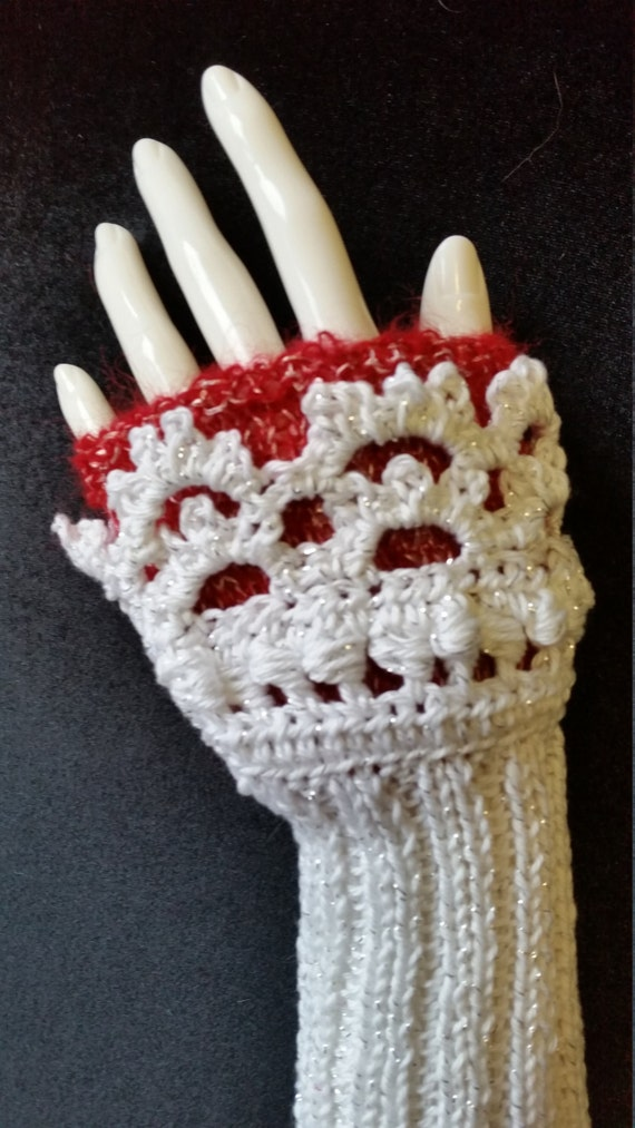 W405.  Hand knitted wristlets with crochet finish