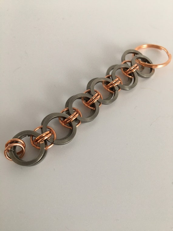 S - 047 Keychain featuring stainless steel and copper