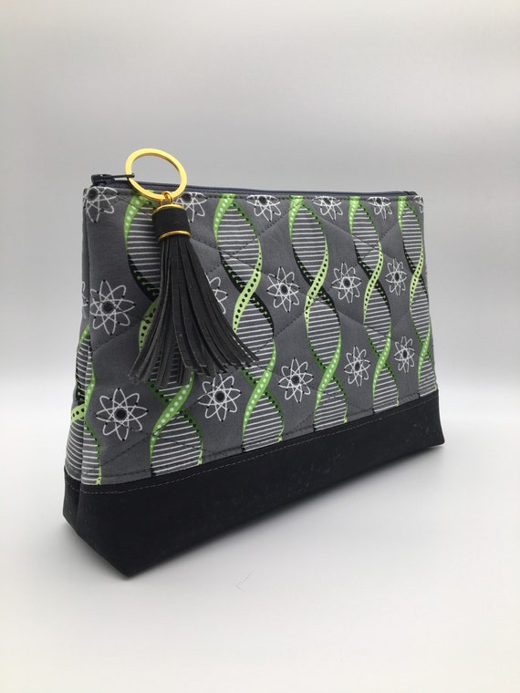 S - 127 Cosmetics/wash bag featuring stunningly designed twisted fabric. Mainly grey and lime green colours