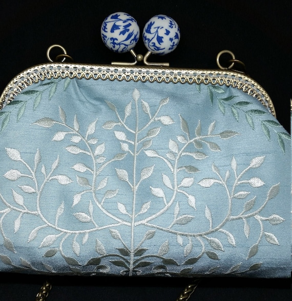 B665.  Pale blue clutch bag with embroidered design
