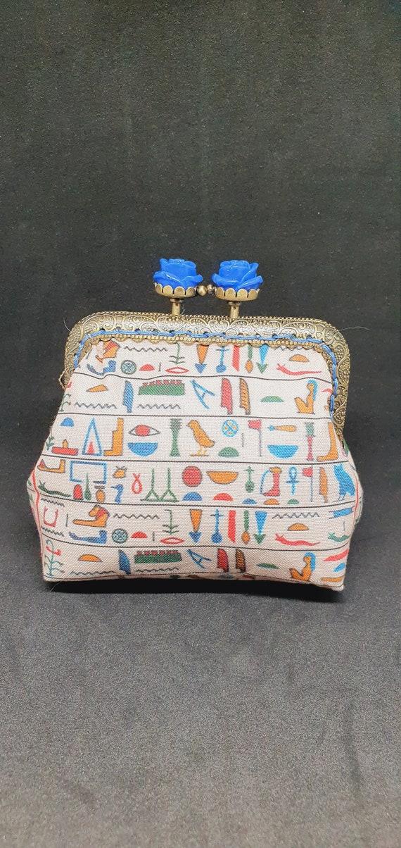 CP728.      The  'Egyptian hieroglyphics' coin purse.