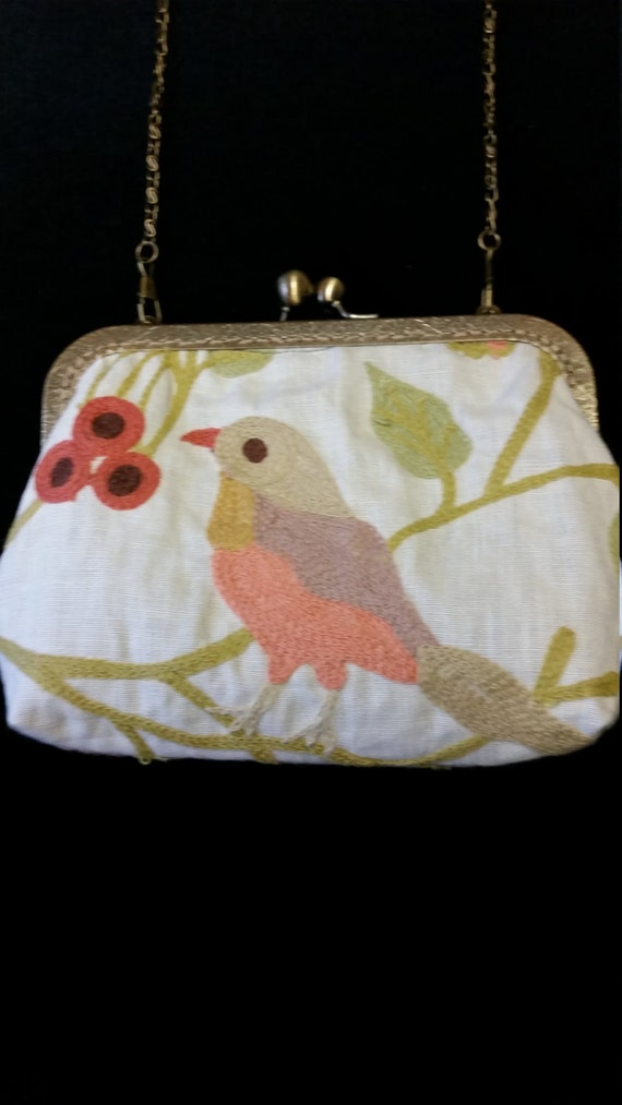 B501.  Small clutch bag with chain and embroidered bird design