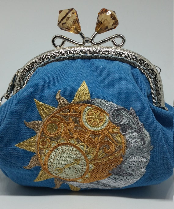 CP666.   The Clockwork Heavens design large coin purse.