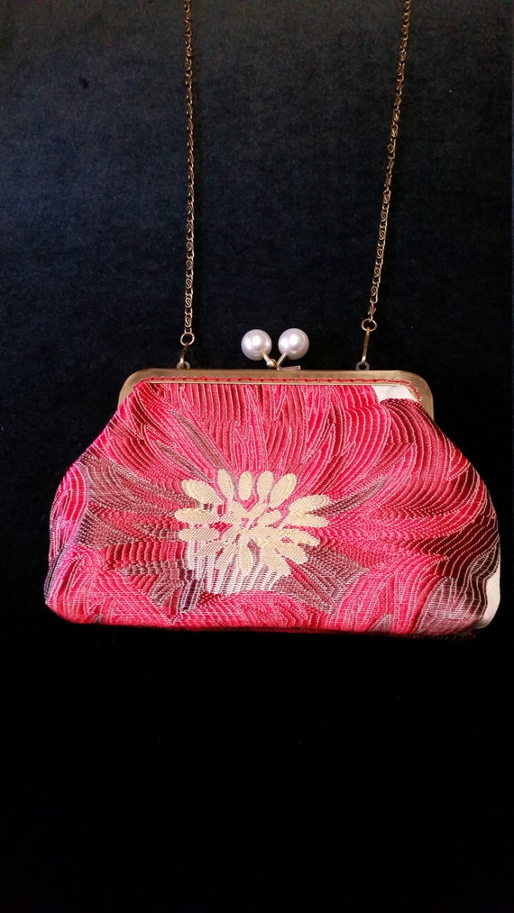 L500.  Small clutch bag with chain and large poppy design