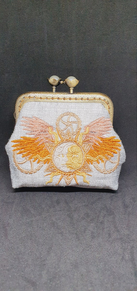 CP738.         The Steampunk alchemy sun and moon coin purse