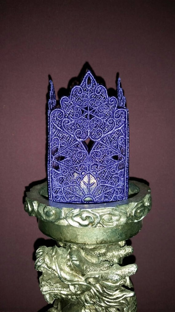 H011.  Deep purple lace tealight.