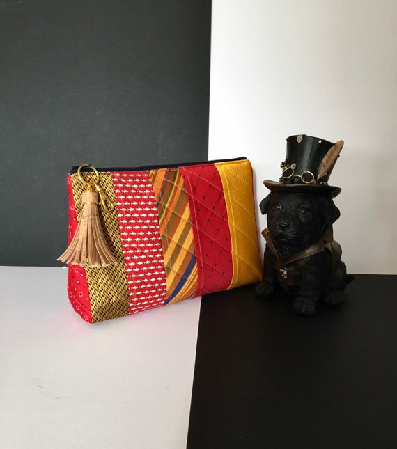 S - 087 Wash bag in bold reds and yellows made by the up cycling of gents ties
