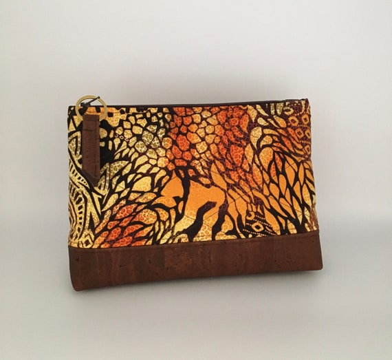 S - 133 Africa print wash bag in stunning warm colours with cork base and zip pull