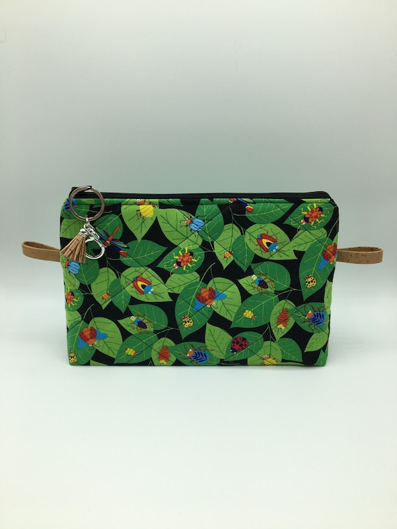 S - 063 Children's washbag with fun bugs and leaves design!