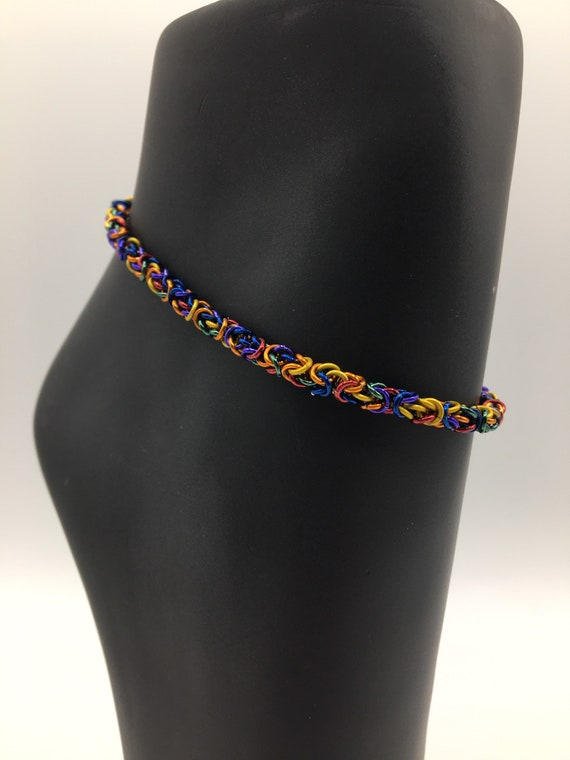 S - 069 Anklet handcrafted with multi coloured, aluminium rings